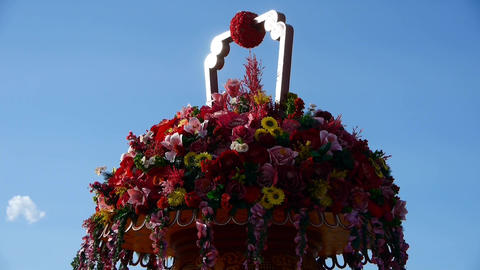 gorgeous baskets full of flowers in wind.clouds in blue sky Stock Video Footage