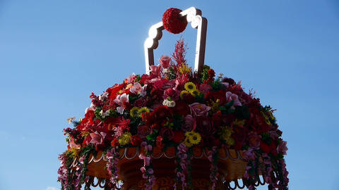 gorgeous baskets full of flowers in wind.blue sky Stock Video Footage