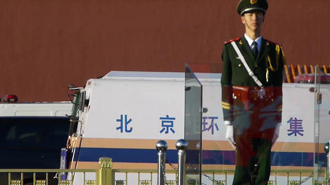 Guard Soldier on Beijing Tiananmen,China socialist red wall.Street traffic Footage