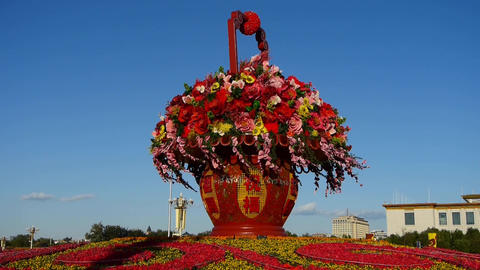 gorgeous baskets full of flowers in blue sky.Beijing Tiananmen Square sunny Footage