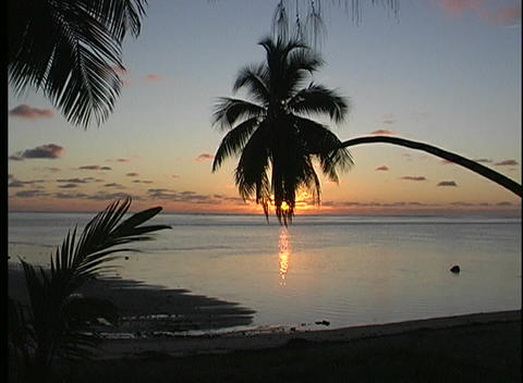 Golden-hour establishing shot of Rarotonga one of the Cook Islands in the South Pacific Footage