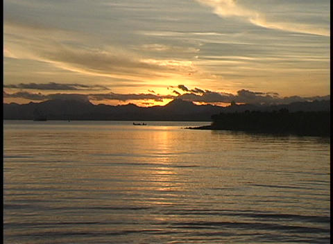 Water moving along the shore in a golden-hour shot of one of the South Pacific Islands Footage