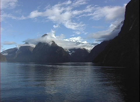 Point-of-view shot from a boat, of rugged mountain peaks,... Stock Video Footage