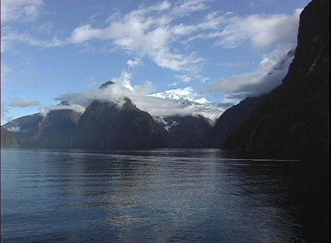 Point-of-view shot from a boat, of rugged mountain peaks, in Milford Sound, New Zealand Footage