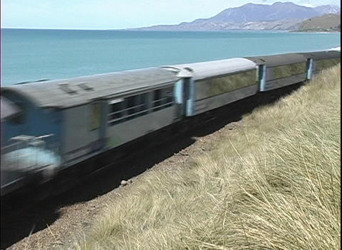 A freight train passes along a scenic coastline in New... Stock Video Footage