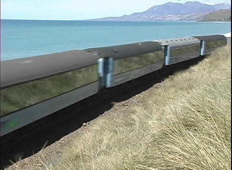 A freight train passes along a scenic coastline in New Zealand Footage