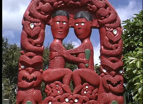 Close-up of a brightly painted Maori carving Stock Video Footage