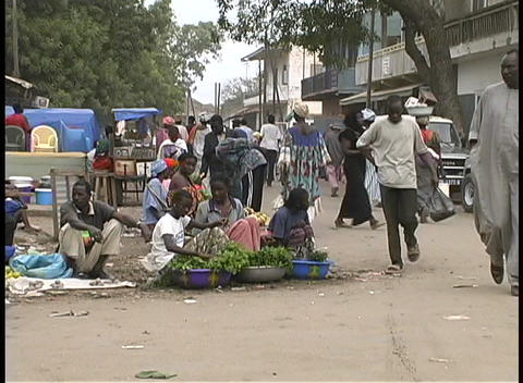 Passersby check out sidewalk vendors at an open-air... Stock Video Footage