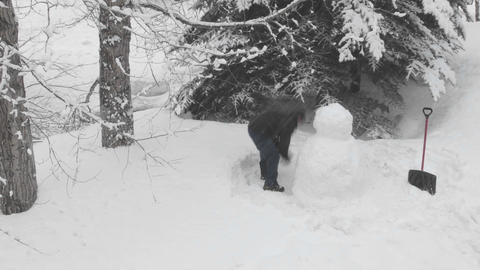 Time lapse of people building a snowman in Vail, Colorado Footage