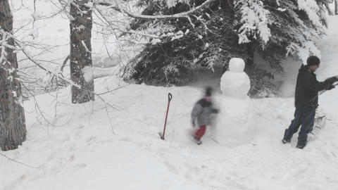 Time lapse of people building a snowman in Vail, Colorado Stock Video Footage