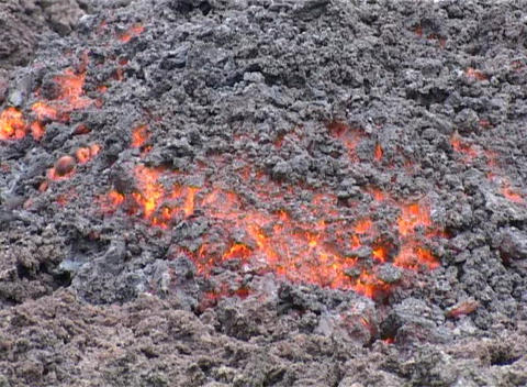 Lava glows under ash Stock Video Footage