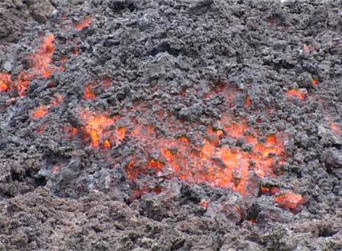 Lava glows under ash Footage