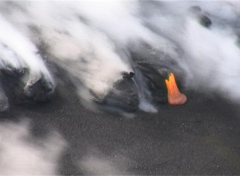 Smoke, ash and steam rise from a lava flow after a volcanic eruption on the island of Reunion Footage