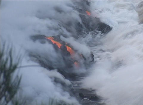 Ocean waves crash in on a lava flow on a Pacific Ocean... Stock Video Footage