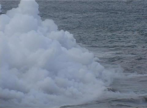 Steam rises in a cloud from the Pacific Ocean as an island is formed from volcanic activity Footage