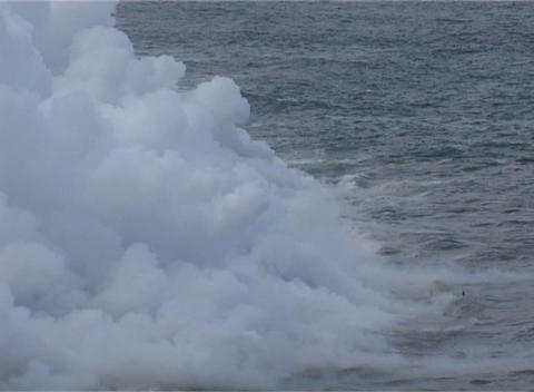 Steam rises in a cloud from the Pacific Ocean as an... Stock Video Footage