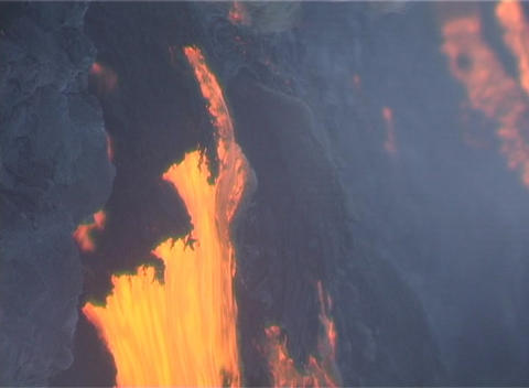 Molten lava flows over a steep hillside Stock Video Footage