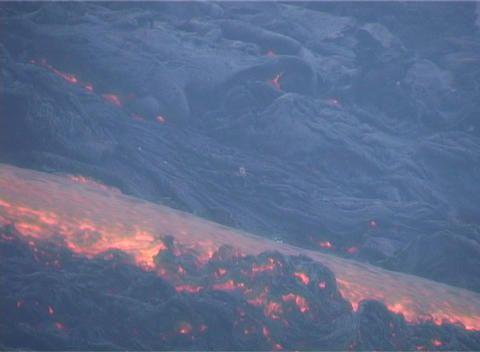 Lava flows down the side of a volcano Stock Video Footage