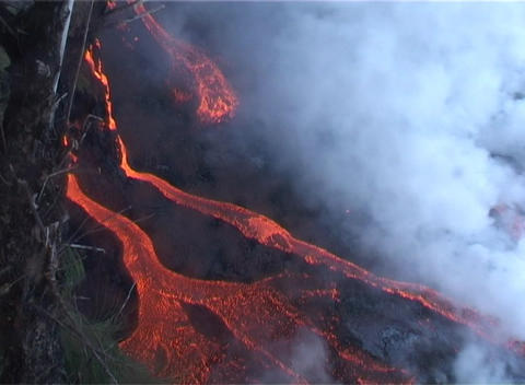 Rivers of red hot lava flow down the slopes of a volcano... Stock Video Footage