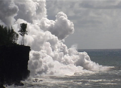 A huge cloud of steam rises as lava meets the ocean... Stock Video Footage