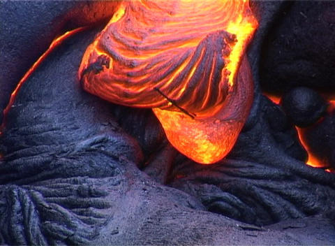 Molten lava oozes during a volcanic eruption Footage