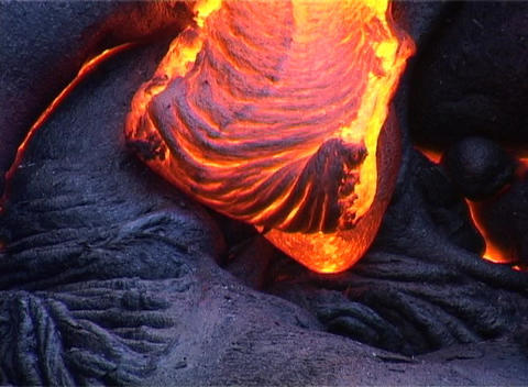 Molten lava oozes during a volcanic eruption Stock Video Footage