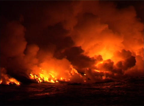 Clouds of flame, smoke, and steam billow into the night... Stock Video Footage