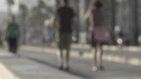 An intentionally blurred shot of pedestrians walking near... Stock Video Footage
