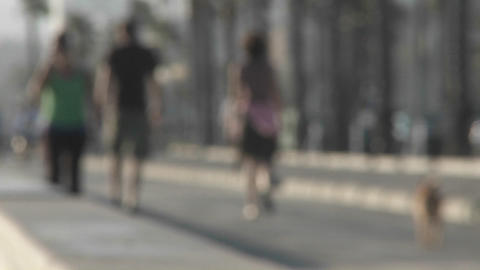 An intentionally blurred shot of pedestrians walking near Santa Monica, California Footage