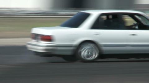 A white car slides through a drifting course at Camarillo... Stock Video Footage