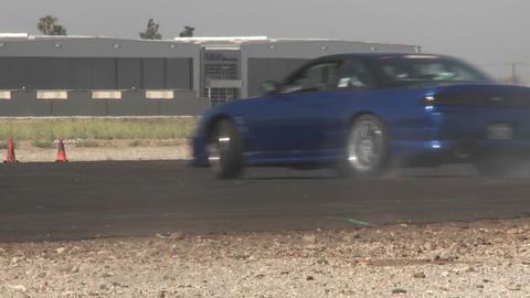 the camera follows a blue car as it glides through a... Stock Video Footage