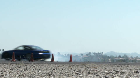 A car performs a drifting maneuver on a test track Stock Video Footage