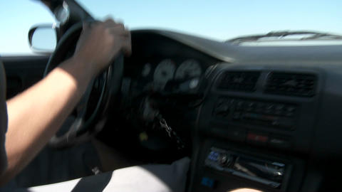 A POV shot from inside a car as a test driver on track... Stock Video Footage
