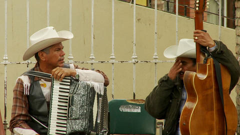 Musicians Chat In Downtown Tijuana Mexico stock footage
