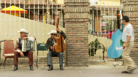 musicians chat in downtown Tijuana Mexico Stock Video Footage