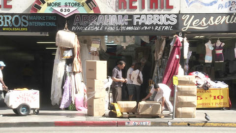 Store vendors unload stock in front of their store in... Stock Video Footage