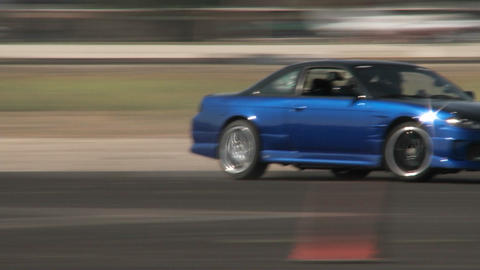 A blue car slides through a drifting course at Camarillo... Stock Video Footage