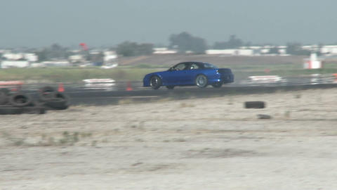 A blue car slides through a drifting course at Camarillo Airport in Camarillo California Footage
