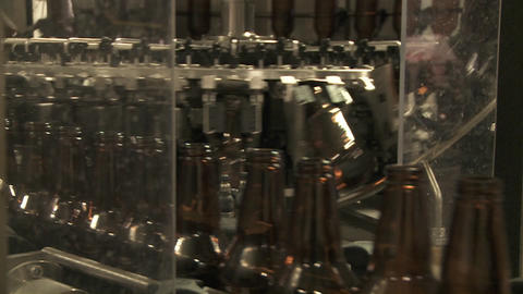 Bottles zip along a conveyor belt in a bottling plant Stock Video Footage