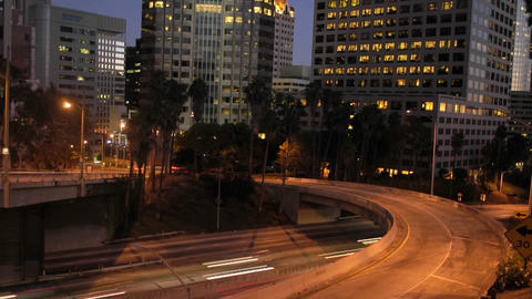 Traffic moves in time lapse along a freeway in downtown Los Angeles Footage