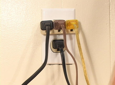 Too many electrical cables are plugged into one outlet in... Stock Video Footage