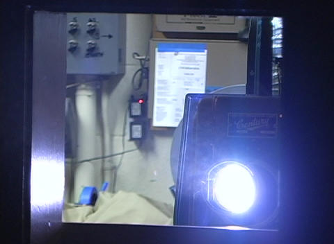 Light from a projector reflects on dust particles Footage