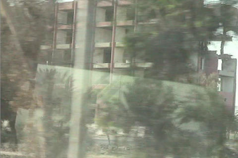 A point of view from a moving vehicle of buildings bombed... Stock Video Footage