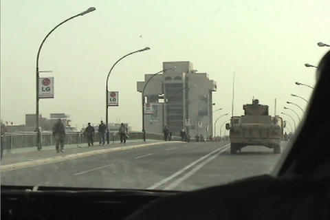 POV from a U S army convoy moving under the victory arch... Stock Video Footage