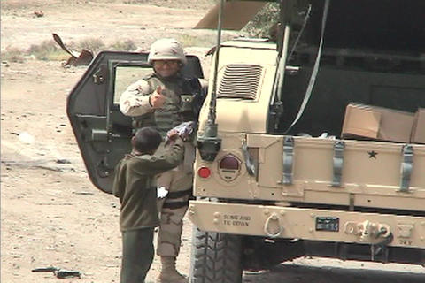 An American soldier hands out toys and other gifts to a... Stock Video Footage