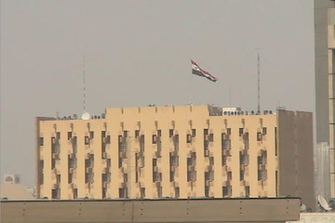 The Iraqi flag flies high above a public building in... Stock Video Footage