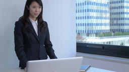 Young Japanese businesswoman doing a presentation in a modern office Footage