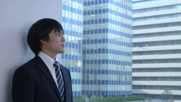 Young Japanese businessman in a modern office Footage