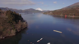 Aerial footage of Mount Fuji and rental boats at Lake Ashi on a Winter morning,  Footage