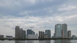 Time-lapse footage of cloudy sky over Tokyo cityscape before sunset, Tokyo, Japa Footage